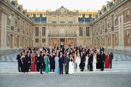 Ryder Cup players and partners on the steps of the Palace of Versailles