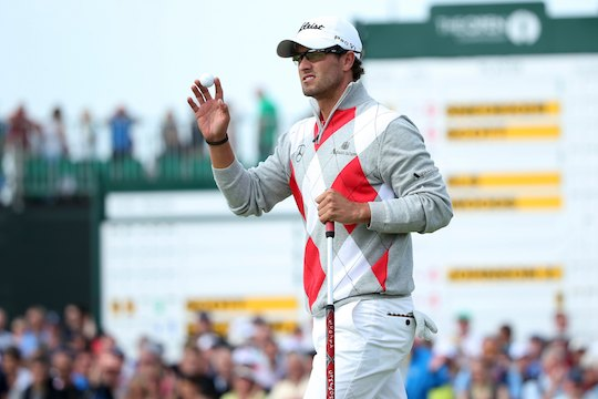 Adam Scott waves to the gallery during the third round of The Open Championship at Royal Lytham & St. Annes  (Photo by Andrew Redington/Getty Images)