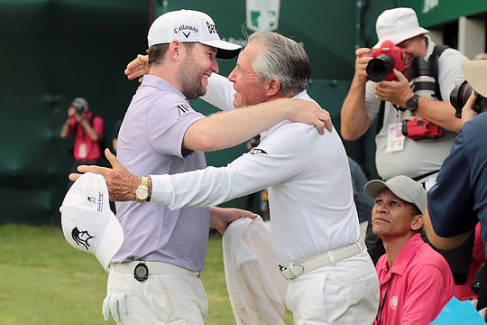 Branden Grace is embraced by Gary Player after his win