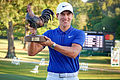 Champ's birdie blitz ends with wire-to-wire victory