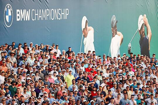 Spectators crowd the 18th green at the BMW Championship