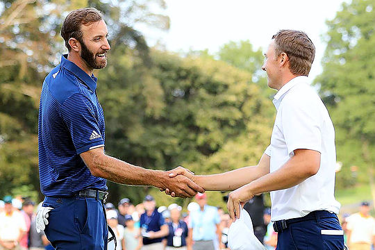 Dustin Johnson shakes hands with Jordan Spieth