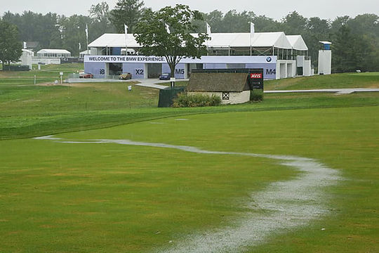 Rain-soaked Aronimink course