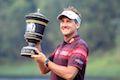 Poulter wins HSBC Champions
