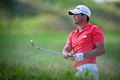 Day shocks Poulter to finish third at WGC