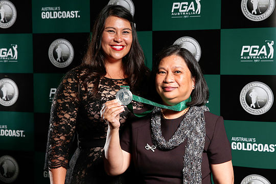 Jason Day's family hold the 2016 Greg Norman Medal