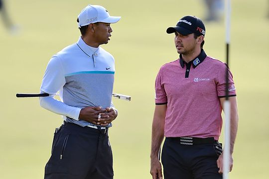 Tiger Woods and Jason Day during the 144th Open Championship