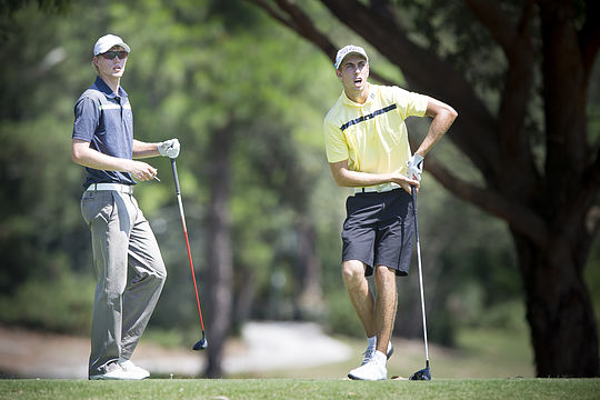 Justin Warren (R) from The Australian Golf Club and Cameron Davis from Monash do battle in their Semi-final match