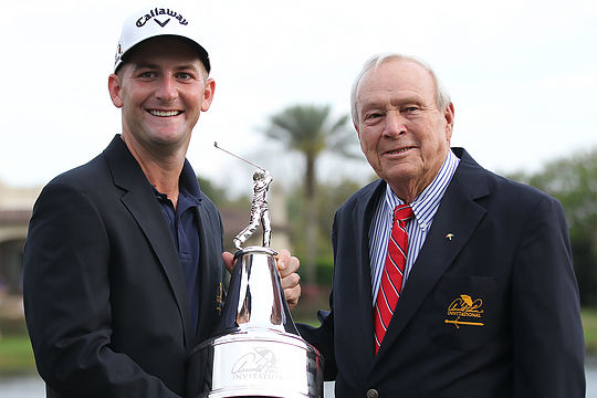 Matt Every holds the trophy with tournament host, Arnold Palmer