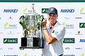 Kuchar grinds out inspirational win in Singapore