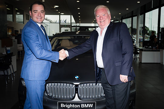 BMW Brighton's Andrew McGillivray with MOTA's Peter Mann
