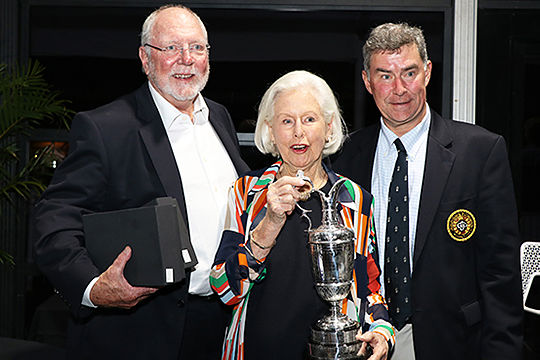 Mary Thomson and son Andrew hold the replica 1965 trophy from the R&A