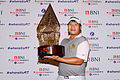 Baby-faced Poom powers to victory in Jakarta