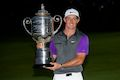 McIlroy emerges from darkness to capture PGA