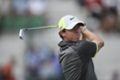 McIlroy repeats 66 to take Open lead