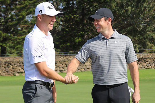 Rory McIlroy greets Justin Thomas at the Sentry Tournament of Champions