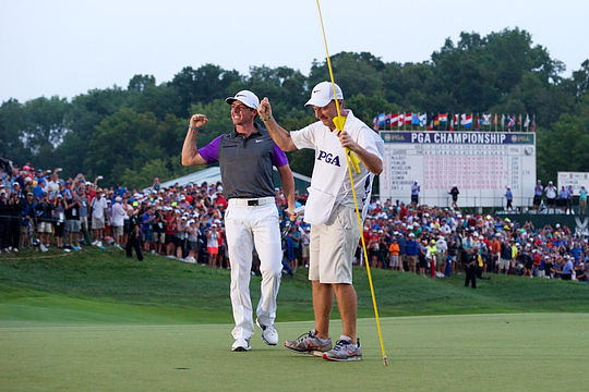 J.P. Fitzgerald celebrates with Rory McIlroy