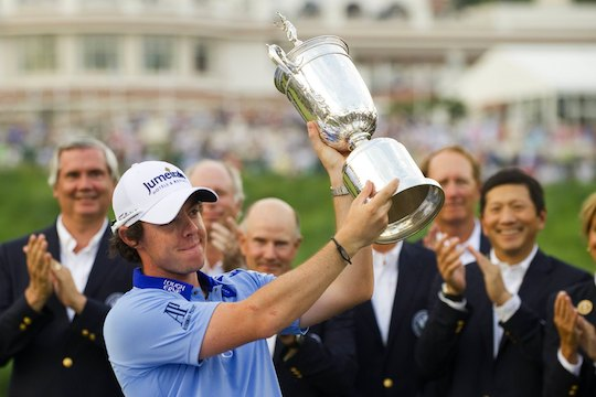 Rory McIlroy holds the 2011 US Open trophy