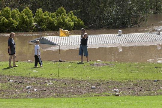 <strong>Water Hazard:</strong> People look at the flooded Sandy Gallop Golf Club