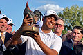 Muñoz birdies 18th, wins playoff for first Tour title