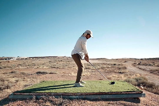 Lang tees off in Coober Pedy