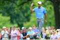 Woods roars into the lead at Bridgestone