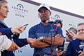 Woods sinks final hole birdie to make Farmers cut