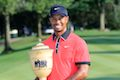 Woods strolls to victory at Bridgestone