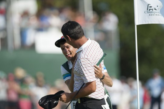 Daniel Popovic and his caddie are all smiles after winning the Australian PGA championship title (Photo: Anthony Powter)