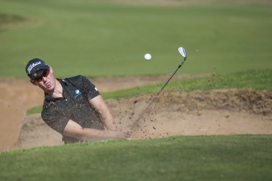 Nathan Holman escapes the green side bunker on the 5th during the final round of the Golf SA Amateur Classic at Glenelg Golf Club in Adelaide (Photo: Anthony Powter)